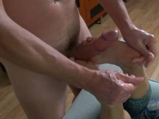 He directs my feet as I wrap my toes around his throbbing cock. I can tell he\'s getting close to cumming from his breaths and moaning~! 