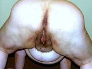 Wife bent over and ready for rear entry.