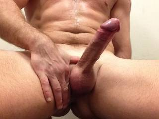 That is one beautiful cock.  I would love to join you. wrap my lips around your cock head then slide my warm wet mouth down your hard cock.