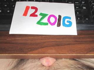 A view of my dick head and the pool of cum on the desk.