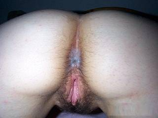 this is one of my personal favorite pics....i just love how her ass is covered with her pussy juice after i was fucking her pussy and flipped her over to get her into doggy position