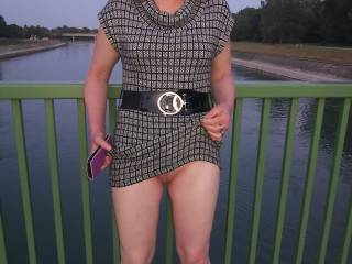 On the bridge, I got her to lift her skirt for all of you. She had to go out without her panties for the first time.