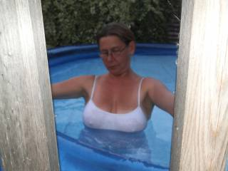 Hubby couldn\'t take his eyes off my boobs as they were getting wetter and wetter and wetter ...What about you? Do they look good in this very clingy and wet top?