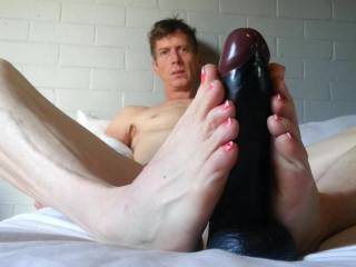Would you love a cock rub with my sexy feet?
