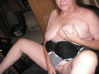 mmmmm I'd love to be standing behind her, holding her other tit and nestling my cock on her neck  xooxox peter