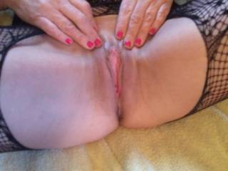 Wait no longer. Love to lick that sweet pussy till it squirts all over my face. Then I can slide my hard cock deep inside.  Nice