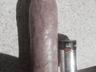 Another shot to compare my shaft to a cuckold\'s. D battery for comparison.