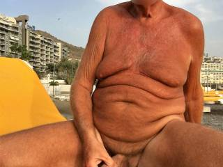 Wanking on sunbed, - lot of people around me. Hope some of them are watching.