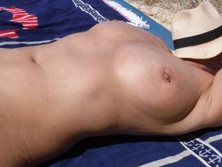 Relaxing at a nude beach in Australia.
