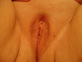 A close-up of my sweet, shaved pussy. Someone with a big cock want to try it on for size?