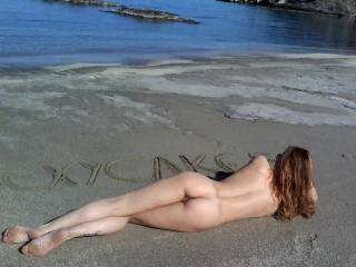 That sexy and tight butt looks ass-pectacular, hunny. That ass and pussy are lying on the sand just begging to be played, fingered, eaten, and fucked sooo much!..