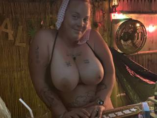 Showing her big tits at the bar again.