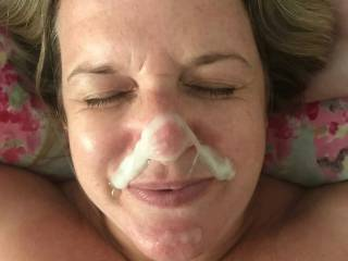 Another big thick load all over her face