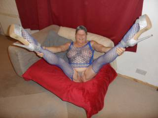 Hi all just me relaxing in my blue body stocking this shows just enough. dirty comments welcome mature couple