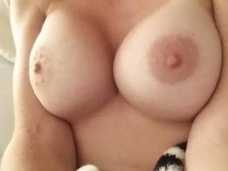 she has shapely tits, lovely crinkly skinned areola round those nipples I'd love to suck, you lucky guy having her to fuck- hope she is always horny