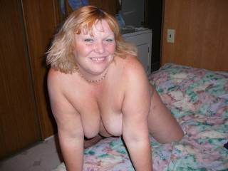 a gorgeous smile , pretty face , lovely boobs - mmmmmm , what a woman