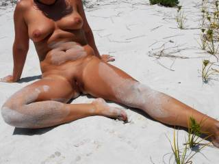 .. sure would enjoy brushing that sand off ... with `lots of `brushes across your nipples and special attention paid to brushing over your pussy lips