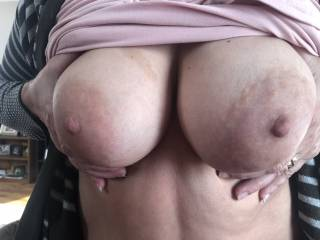 Look at her beautiful tits. Love those sexy areolas !  I'm a lucky man!!