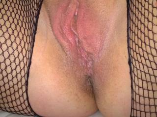 Crotchless bodystocking. Perfect access to her delicious pussy.