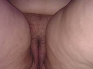 Her puffed up pussy lips conceal a whole load of cum