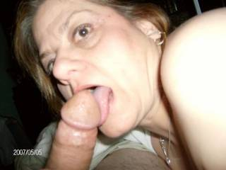 Just licking it before I deep throat it.  Makes my pussy squirt when it slides all the way down.  Love sucking his fat cock and getting all that creamy cum.