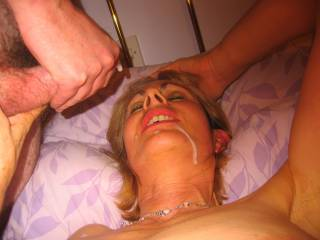 Her hubby watched me firstly fuck her and then give her a facial, she is one naughty GILF,what do you think?