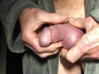 Fondling my cock and balls, swollen by a cock ring.