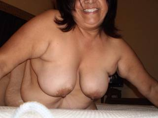 Great pic! Nice pair of titty's and from what I can see a beautiful belly!! Thanks for posting!!!