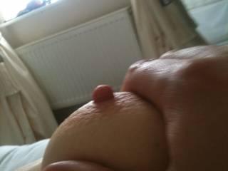 Bite, lick, suck... whatever you want.  Sweet nipple.