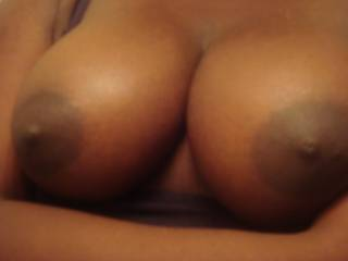omg I love those titties!!! I wanna oil them up and slid my fat cock between them and get to work on covering those titties with some warm love juice!!!