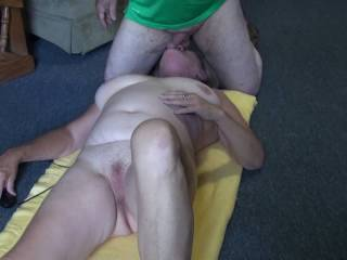 Love sucking on him in this position. Would you like to see the rest of the video and him cumming all over my tits?