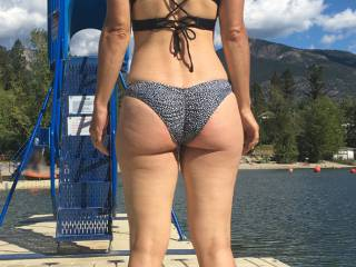 She wanted to swim to the dock and have some photos taken. We had the attention of everyone on the beach.I always want to spank that ass. Would you?