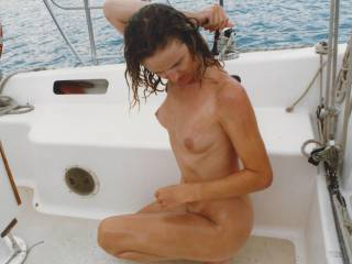 Sarah taking a shower on a yacht after being fucked.  Tell us what you think of her?