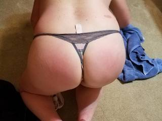 Wife\'s ass in thong. Sorry about the tag sticking out, my fault.