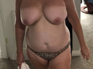 Showing off her hot mature body and nice tits. She likes to show off.
