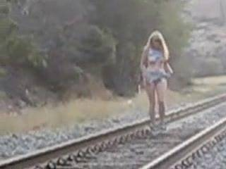 Gisela finds some time outdoors to play with her gorgeous tits while a train passes