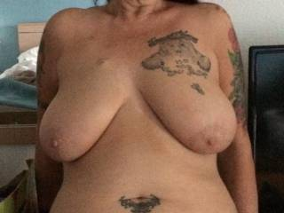She never wears a bra or panties. I like to pull down on her tits by the nipples.  I want her nips pointing straight down. I pull the nipples and do circles,stretching them and making them looser and floppier. Shaping her has been a lot of fun.