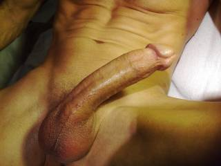 My cock and balls with a coating of oil. It wasn\'t too long before I was squirting out a big load.