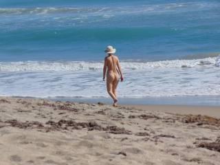 nude women walking on beach