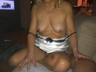 My mature wife before she sucked my cock. Do you like her tits? She\'s 60 years old.