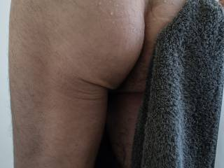 #2-One of three from yesterday\'s shower. I was going to post this in black and white, but I like the contrast of the bluish grey towel against my skin. Despite a few days of privacy and too much time on my hands, I seem to be in a non-explicit period.