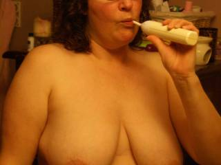 Sexy Mormon lady brushing her teeth, think she is cleaning after swallowing a big load?