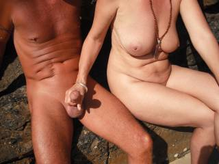 Playing with our nudist friend\'s lovely smooth tight cut cock at the local nude beach when it was quiet