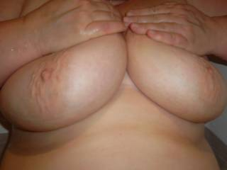I would love to see more! Such great tits, my cock would go really well between them ;)
