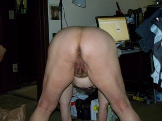 I'm hot and ready too, I would love to have my hard cock deep inside her pussy, and doggy is my favourite position, and looking so inviting bending over like that.