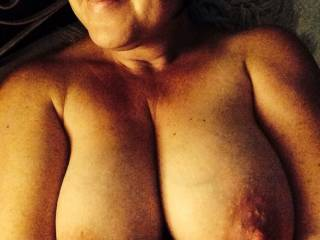 Love her large tits, and crinkly skinned areola round those big nipples I'd waant to suck. Subtle vein tracery is always sexy too