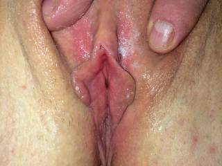 Spreading her lips open. Wish we had a woman to help me make her cum.