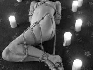 very nicely done  wished you would have turned her over and showed her   tied  that way as well   the candles are a nice touch