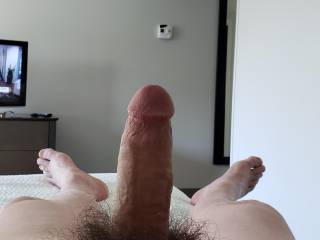 Hard and horny in a hotel room! Would you suck it?