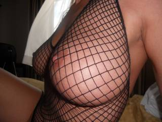 Let me wrap those beauties around my hard cock and go to town. Beautiful big knockers and I love the fishnet as well
